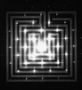 Labyrinth Produced with a custom made laser-driven camera that reduces images to light points. The image is a Magritte painting.